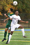 WATERBURY  CT. - 14 October 2019-101419SV12- #18 Luke Zipoli of Holy Cross High and #9 Chris Akinduro of Naugatuck High battle for the ball during NVL Soccer action in Waterbury Monday. <br />Steven Valenti Republican-American