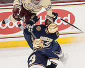 Quinn Smith (BC - 27), Eric Johnson (ND - 23) - The visiting University of Notre Dame Fighting Irish defeated the Boston College Eagles 2-1 in overtime on Saturday, March 1, 2014, at Kelley Rink in Conte Forum in Chestnut Hill, Massachusetts.