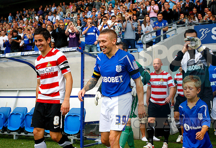 Craig Bellamy of Cardiff City leads out his team on his debut