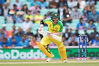 David Warner (Australia) defends a good delivery from Bhuvneshwar Kumar (India) during India vs Australia, ICC World Cup Cricket at The Oval on 9th June 2019