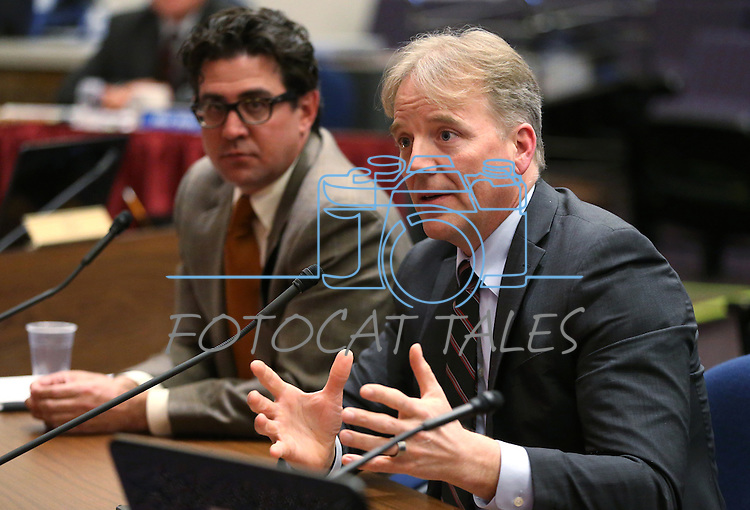 Jeremy Aguero, with Applied Analysis, left, and eBay executive Dean Nelson testify in a hearing at the Legislative Building in Carson City, Nev., on Tuesday, Feb. 17, 2015.    <br /> Photo by Cathleen Allison