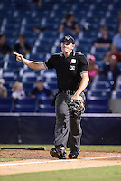 Home plate umpire Derek Ivinski signals fair ball on a home run during a game between the Daytona Tortugas and Tampa Yankees on April 24, 2015 at George M. Steinbrenner Field in Tampa, Florida.  Tampa defeated Daytona 12-7.  (Mike Janes/Four Seam Images)