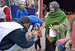 Staff from ACT Alliance member Hungarian Interchurch Aid offer food to a young refugee at Beremend, along Hungary's border with Croatia. Hundreds of thousands of refugees and migrants flowed through Hungary in 2015 on their way to western Europe from Syria, Iraq and other countries.