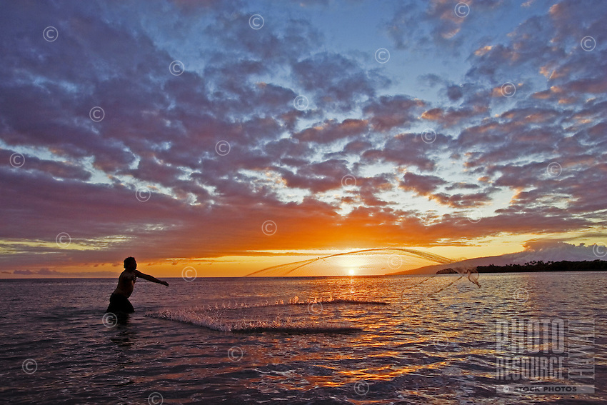 A throw net fisherman is silhouetted at sunset at Olowalu, Maui.