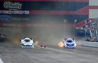 Jun. 19, 2011; Bristol, TN, USA: NHRA funny car driver Mike Neff (left) races alongside teammate Robert Hight during eliminations at the Thunder Valley Nationals at Bristol Dragway. Mandatory Credit: Mark J. Rebilas-
