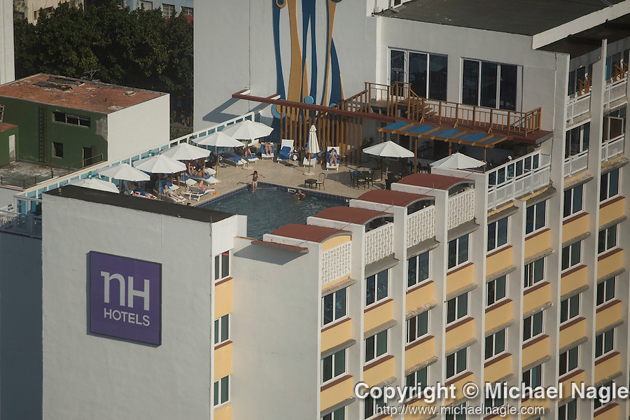 HAVANA, CUBA -- MARCH 23, 2015:  Guests at the Capri Hotel use the rooftop pool in Havana, Cuba on March 23, 2015. Photograph by Michael Nagle