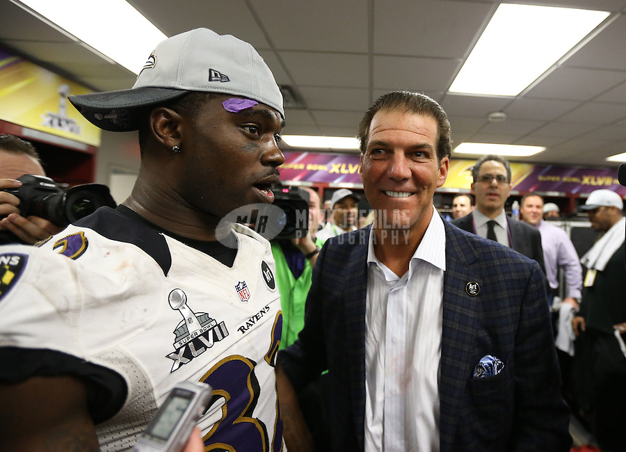 Feb 3, 2013; New Orleans, LA, USA; Baltimore Ravens owner Steve Bisciotti celebrates with safety James Ihedigbo in the locker room after defeating the San Francisco 49ers in Super Bowl XLVII at the Mercedes-Benz Superdome. Mandatory Credit: Mark J. Rebilas-