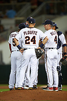 Minnesota Twins manager Paul Molitor (4) makes a pitching change with Eduardo Escobar (5), Trevor Plouffe (24), and catcher Kurt Suzuki (right) during a Spring Training game against the Boston Red Sox on March 16, 2016 at Hammond Stadium in Fort Myers, Florida.  Minnesota defeated Boston 9-4.  (Mike Janes/Four Seam Images)