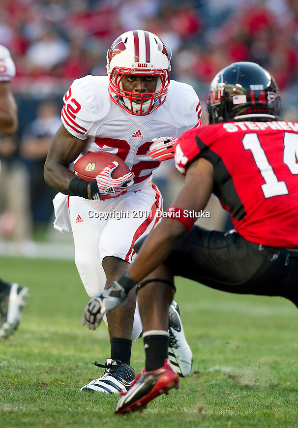 Wisconsin Badgers running back Jeff Lewis (22) carries the ball during an NCAA college football game against the Northern Illinois Huskies on September 17, 2011 in Chicago. The Badgers won 49-7. (Photo by David Stluka)