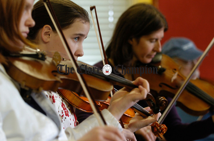 Leah Kenny, centre in fiddle class during the Ennis Trad Festival. Photograph by John Kelly.