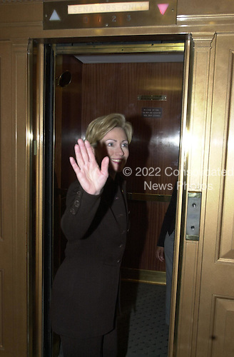 Washington, DC - March 28, 2001 -- United States Senator Hillary Rodham Clinton (Democrat of New York) waves as she enters an elevator in the U.S. Capitol following her participation in a prayer group in Washington, D.C. on March 28, 2001..Credit: Ron Sachs / CNP