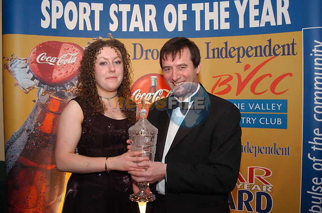 Sport Star of the Year 2003 Sponsored by Drogheda Concentrates in Association with the Boyne Valley Country Club..Hugo reidy Drogheda Concentrates presents Young Sport star of the year 2003 to Jennifer Dunne.Photo Fran Caffrey/Newsfile.ie...This Picture has been sent to you by Newsfile Ltd..The Studio,.Millmount Abbey,.Drogheda,.Co. Meath,.Ireland..Tel: +353(0)41-9871240.Fax: +353(0)41-9871260.ISDN: +353(0)41-9871010.www.newsfile.ie..general email: pictures@newsfile.ie