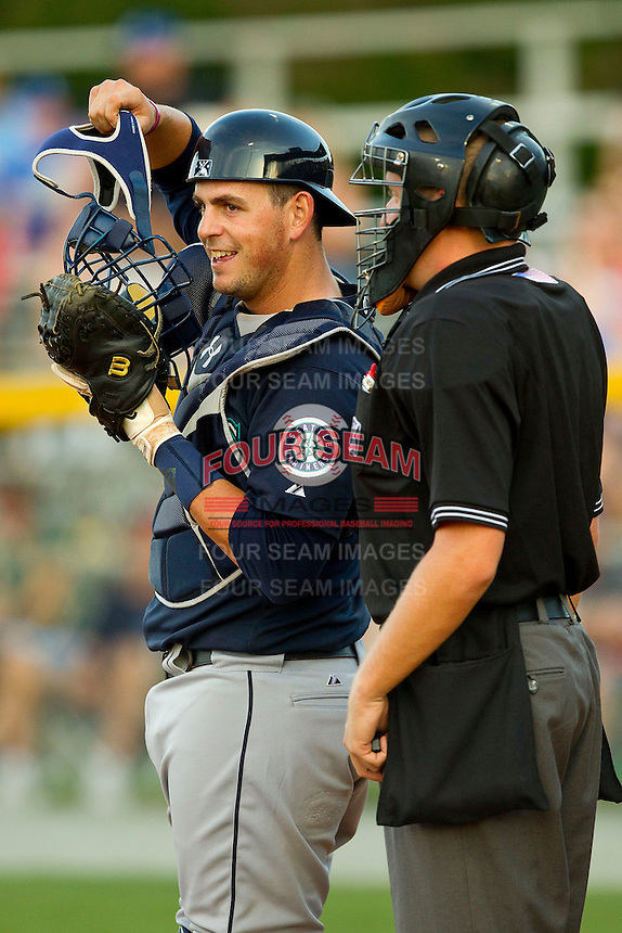 Pulaski Mariners catcher Toby Demello (6) chats with home plate umpire Matt Kainz during the Appalachian League game against the Burlington Royals at Burlington Athletic Park on June20 2013 in Burlington, North Carolina.  The Royals defeated the Mariners 2-1 in 13 innings.  (Brian Westerholt/Four Seam Images)
