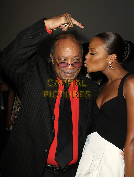 QUINCY JONES & EVA MARCILLE PIGFORD.2nd Annual Essence Black Women In Hollywood Luncheon held at The Beverly Hills Hotel, Los Angeles, California, USA..February 19th, 2009.half length black dress suit white skirt hand pointing profile kiss kissing .CAP/ADM/KB.©Kevan Brooks/AdMedia/Capital Pictures.