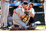 26 August 2007:  Washington Nationals catcher Jesus Flores is tended to after getting hit on the side of his mask during a game against the Colorado Rockies at Coors Field in Denver, Colorado. The Rockies defeated the Nationals 10-5 to sweep the 3-game series...Mandatory Photo Credit: Ed Wolfstein Photo