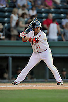 Designated hitter Michael Chavis (11) of the Greenville Drive bats in a game against the Greensboro Grasshoppers on Wednesday, August 26, 2015, at Fluor Field at the West End in Greenville, South Carolina. Chavis was a first-round pick of the Boston Red Sox in the 2014 First-Year Player Draft. Greenville won, 7-0. (Tom Priddy/Four Seam Images)