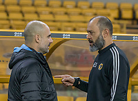 27th December 2019; Molineux Stadium, Wolverhampton, West Midlands, England; English Premier League, Wolverhampton Wanderers versus Manchester City; The Head Coach of Wolverhampton Wanderers Nuno Espirito Santo with Manchester City Manager Pep Guardiola before the kick off  - Strictly Editorial Use Only. No use with unauthorized audio, video, data, fixture lists, club/league logos or 'live' services. Online in-match use limited to 120 images, no video emulation. No use in betting, games or single club/league/player publications