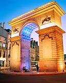 FRANCE, Burgundy, exterior of illuminated arch at night, Dijon