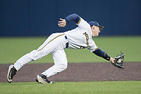 Michigan Wolverines second baseman Jimmy Kerr (15) snags a line drive against the Michigan State Spartans on May 19, 2017 at Ray Fisher Stadium in Ann Arbor, Michigan. Michigan defeated Michigan State 11-6. (Andrew Woolley/Four Seam Images)