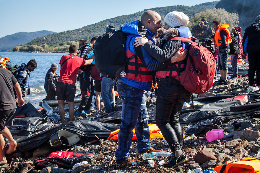 A newlywed Syrian couple kisses after landing on the island of Lesbos after crossing with about 50 others from Turkey in a rubber dingy.