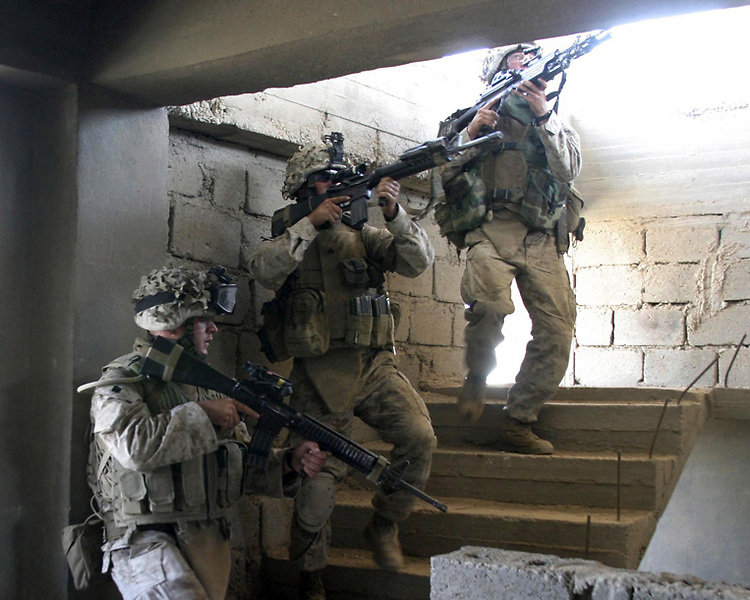 HIT, Iraq- Marines from 3rd Platoon, India Company, 3rd Battalion, 1st Marine Regiment clear a stairway in a building near Forward Operating Base 1. The Marines of Regimental Combat Team 2 conduct counter-insurgency operations with Iraqi Security Forces to isolate and neutralize anti-Iraqi forces, to support the continued development of Iraqi Security Forces, and to support Iraqi reconstruction and democratic elections in order to create a secure environment that enables Iraqi self-reliance and self-governance. (Official USMC photo by Lance Cpl. Shane S. Keller)