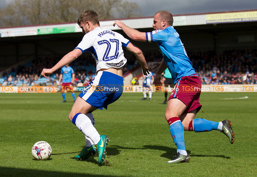 Laurence Maguire (Chesterfield) and Stephen Dawson of Scunthorpe during Scunthorpe United vs Chesterfield, Sky Bet EFL League 1 Football at Glanford Park on 17th April 2017