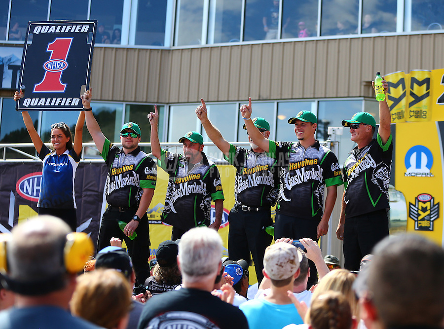 Jul 24, 2016; Morrison, CO, USA; NHRA pro stock driver Alex Laughlin (second from right) with crew members during the Mile High Nationals at Bandimere Speedway. Mandatory Credit: Mark J. Rebilas-USA TODAY Sports