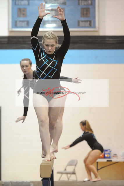 Kathryn Paul warms up on the balance beam during Thursday's meet.  Photo for the Star by Michael Dinneen