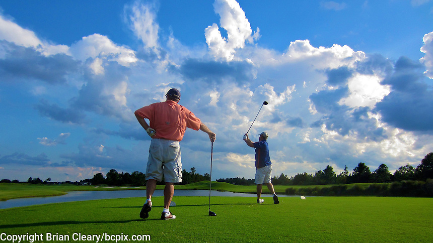 Golfing under blue sky and fluffly Florida clouds, October 2011.  (Photo by Brian Cleary/www.bcpix.com)