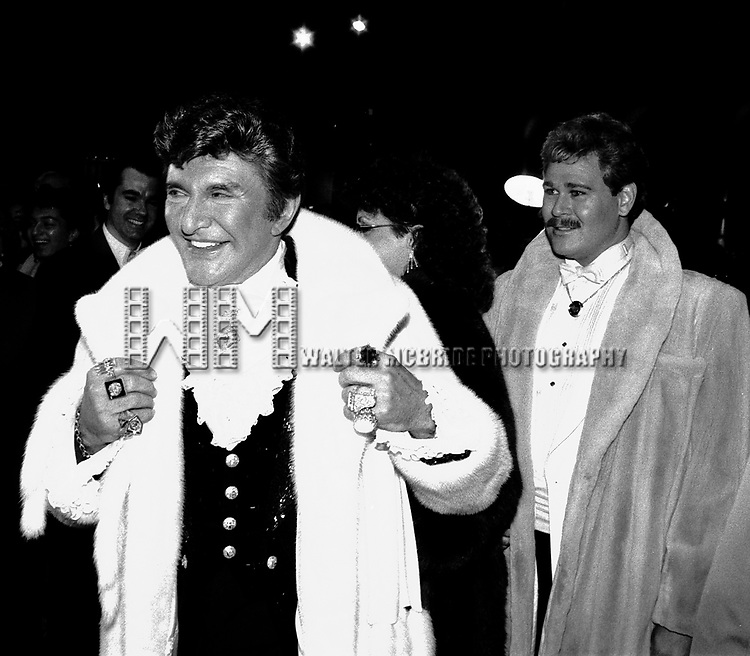 Liberace and boyfriend Carey James attending the after party held at the Trump Tower celebrating his opening night performance at Radio City Music Hall..April 1985