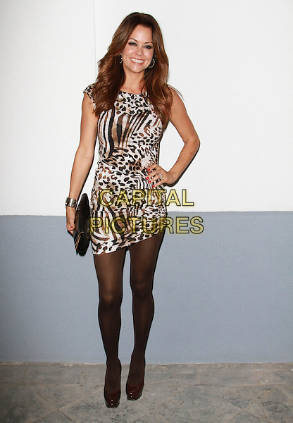 BROOKE BURKE.UK Style by French Connection Launch Party held at the Lexington Social House, Hollywood, California, USA,.9th March 2011..full length animal leopard print white dress sleeveless black tights platform shoes hand on hip print animal brown clutch bag  .CAP/ADM/KB.©Kevan Brooks/AdMedia/Capital Pictures.