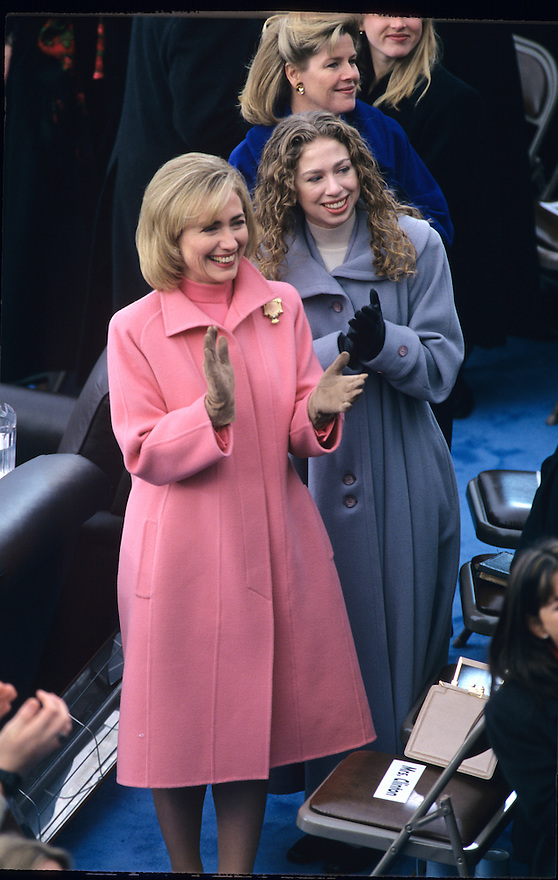 First Lady Hillary Clinton and daughter Chelsea clap as  President Bill Clinton arrives at the US Capitol to be sworn in to a second term at President.