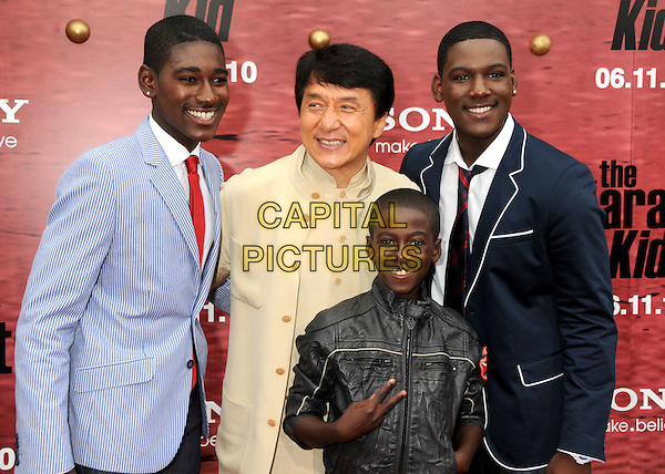 "KWAME BOATENG, JACKIE CHAN, KWESI BOAKYE & KOFI SIRIBOE.""The Karate Kid"" Los Angeles Premiere held at Mann's Village Theatre, Westwood, California, USA,  .7th June 2010..half length blue suit jacket red tie cream beige black leather navy blue blazer v peace sign hand gesture .CAP/ADM/BP.©Byron Purvis/AdMedia/Capital Pictures."