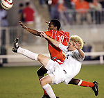 9 November 2005: Virginia's Matt Poole (right) clears the ball away from Clemson's Dane Richards (10). Clemson University defeated the University of Virginia 4-1 at SAS Stadium in Cary, North Carolina in a quarterfinal of the 2005 ACC Men's Soccer Championship.