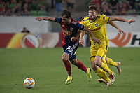 Boban Nikolov (L) of Vidi FC and Evgeni Yablonski (R) of FC BATE Borsiov fight for the ball during the UEFA Europa League match between Hungary's Videoton FC and Belarus' FC BATE Borisov at the Groupama Arena stadium in Budapest, Hungary on Sept. 20, 2018. ATTILA VOLGYI