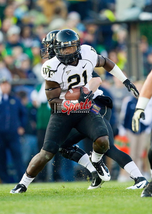 Deandre Martin (21) of the Wake Forest Demon Deacons looks for running room against the Notre Dame Fighting Irish at Notre Dame Stadium on November 17, 2012 in South Bend, Indiana.  The Fighting Irish defeated the Demon Deacons 38-0.  (Brian Westerholt/Sports On Film)