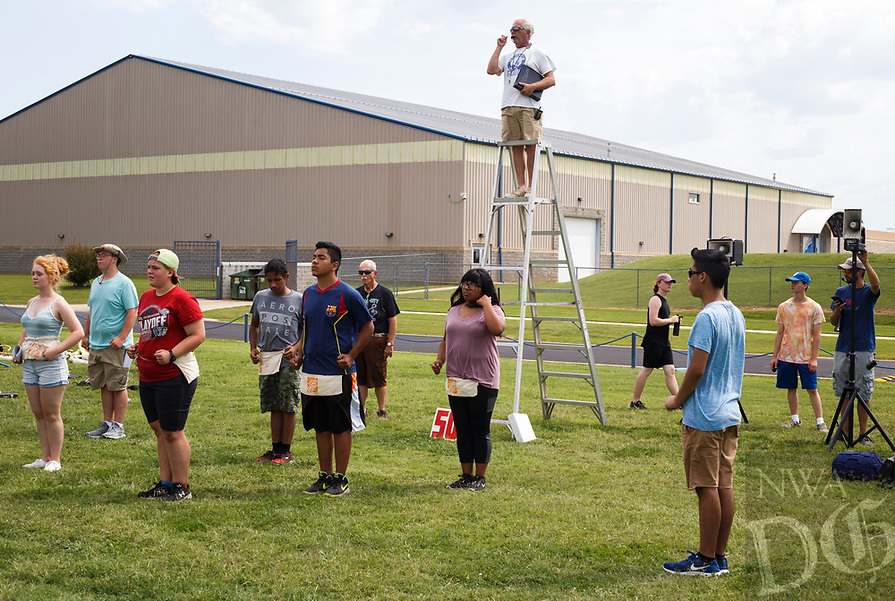 NWA Democrat-Gazette/CHARLIE KAIJO Band director <br />Bill Rowan (top center) directs his band during a band practice, Monday, August 6, 2018 at Rogers High School in Rogers. <br /><br />The students practiced drills for this year's halftime shows. All of their music this year will be from Russian classical composers including Tchaikovsky and Mussorgsky. The band will also participate in the Region Marching Assessment and the Heritage War Eagle marching competition in October.