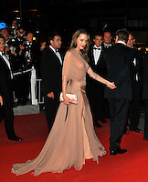 ANGELINA JOLIE &amp; BRAD PITT <br /> Leaving the premiere of &quot;Inglorious Basterds&quot;  at the Grand Theatre Lumiere  during the 62nd Cannes International Film Festival, Cannes, France, <br /> May 20th 2009.<br /> full length departures black suit tux tuxedo Tom Ford long beige peach silk dress maxi draped v-neck clutch bag satin shoes open toe cream couple leaving walking bow tie white shirt leg thigh slit split holding hands <br /> CAP/PL<br /> &copy;Phil Loftus/Capital Pictures /MediaPunch ***NORTH AND SOUTH AMERICAS ONLY***
