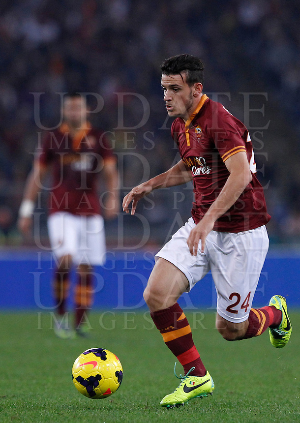 Calcio, Serie A: Roma vs ChievoVerona. Roma, stadio Olimpico, 31 ottobre 2013.<br /> AS Roma midfielder Alessandro Florenzi in action during the Italian Serie A football match between AS Roma and ChievoVerona at Rome's Olympic stadium, 31 October 2013.<br /> UPDATE IMAGES PRESS/Isabella Bonotto