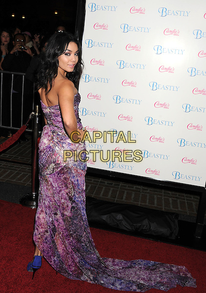 "VANESSA HUDGENS .arriving at the Los Angeles film premiere of ""Beastly"" at Pacific Theaters at The Grove in Los Angeles, California, USA, February 24th, 2011..full length strapless purple print dress long maxi train hand on hip shoes bustier peep toe blue back over shoulder  rear behind .CAP/ROT/TM.©Tony Michaels/Roth Stock/Capital Pictures"