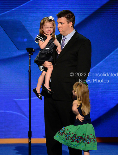 "Stacey Lihn's daughter cries and is comforted by her father and sister as her mother makes remarks in favor of ""Obamacare"" at the 2012 Democratic National Convention in Charlotte, North Carolina on Tuesday, September 4, 2012.  Her husband and daughters stand at right..Credit: Ron Sachs / CNP.(RESTRICTION: NO New York or New Jersey Newspapers or newspapers within a 75 mile radius of New York City)"