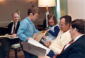 Bethesda, Maryland - May 5, 1991 -- United States President George H.W. Bush was greeted by two of his grandchildren, Sam and Ellie LeBlond in the Presidential Suite at Bethesda Naval Hospital in Bethesda, Maryland on May 5, 1991.  The President was meeting with Chief of Staff John Sununu, right, and National Security Advisor Brent Scowcroft, left.  Sam and Ellie are the children of the President's daughter, Dorothy..Credit: White House via CNP