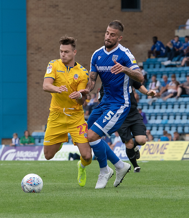 Bolton Wanderers' Dennis Politic (left) battles for possession with Gillingham's Max Ehmer (right)  <br /> <br /> Photographer David Horton/CameraSport<br /> <br /> The EFL Sky Bet League One - Gillingham v Bolton Wanderers - Saturday 31st August 2019 - Priestfield Stadium - Gillingham<br /> <br /> World Copyright © 2019 CameraSport. All rights reserved. 43 Linden Ave. Countesthorpe. Leicester. England. LE8 5PG - Tel: +44 (0) 116 277 4147 - admin@camerasport.com - www.camerasport.com