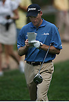 6 September 2008:   Jim Furyk checks course notes in the third round of play at the BMW Golf Championship at Bellerive Country Club in Town & Country, Missouri, a suburb of St. Louis, Missouri. Furyk was the leader after the conclusion of round two with a score of 62.  After the first nine holes of the 18-hole third round, Furyk was 11 under-par.  The BMW Championship is the third event of the Fed Ex Cup and the top 30 finishers will qualify for the next event of the championship.