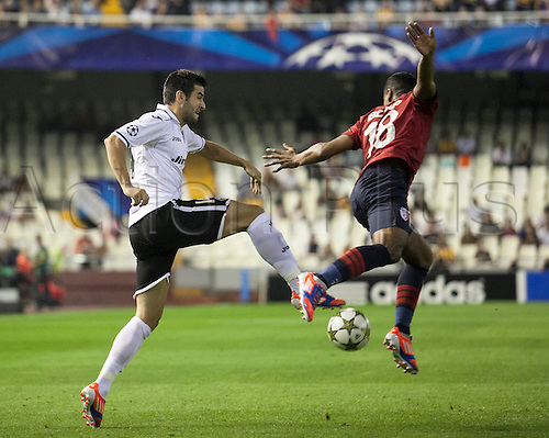 02.10.2012 Valencia, Spain. Defender Antonio Barragan of Valencia CF duels for the ball with Defender Franck Beria of LOSC Lille, during the Champions League Group G game between Valencia   and Lille from Mestalla, Valencia, Spain.