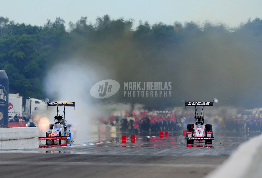 Aug. 20, 2011; Brainerd, MN, USA: NHRA top fuel dragster driver Dom Lagana (left) explodes an engine alongside Shawn Langdon during qualifying for the Lucas Oil Nationals at Brainerd International Raceway. Mandatory Credit: Mark J. Rebilas-