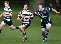 Saturday 3rd March 2012; Andrew Irvine in action is tackled by Adam Rainey during the Medallion Shield semi-final between Wallace High School and Dromore High School at Osborne Park, Belfast. <br /> Picture credit: John Dickson / DICKSONDIGITAL