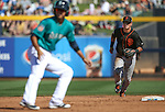 SF Giants' Joe Panik makes a play against the Seattle Mariners a spring training game in Peoria, Ariz., on Wednesday, March 16, 2016. <br />