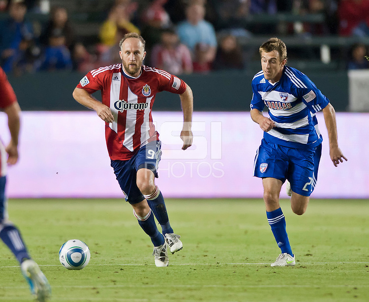 CARSON, CA – June 18, 2011: Chivas USA midfielder Simon Elliott (9) and FC Dallas midfielder Eric Alexander (24) during the match between Chivas USA and FC Dallas at the Home Depot Center in Carson, California. Final score Chivas USA 1, FC Dallas 2.