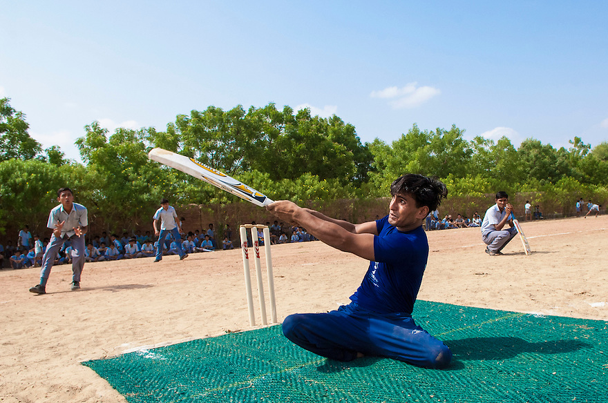 Janak Singh, 19,  participate in a game of cricket at the Sucheta Kriplani Shiksha Niketan school for disabled children on the outskirts of Jodhpur in the northen Indian state of Rajasthan.